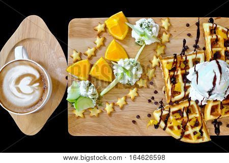 Traditional Belgian waffles with ice cream fruit and coffee mocca