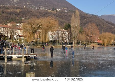 Sunday January 8 2017-Lake Endine-Bergamo-Lombardia-Italy-A crowd of unidentified people enjoy walking on the rare phenomenon of glaciation of Lake Endine just 373 m.s.l.