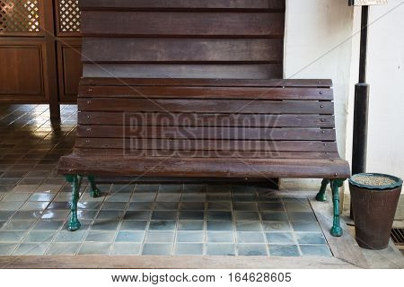 Old wooden bench in public train station stock photo