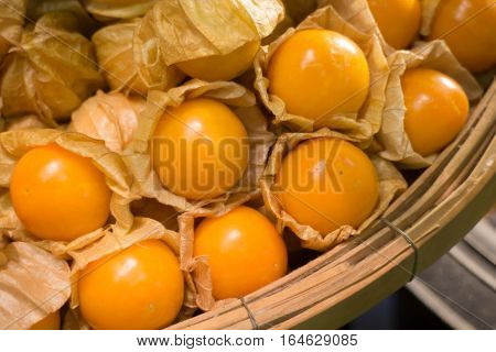 Cape gooseberry (Physalis Peruviana) in bamboo basket stock photo