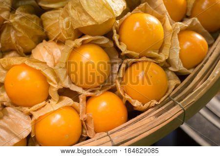 Cape gooseberry (Physalis Peruviana) in bamboo basket stock photo