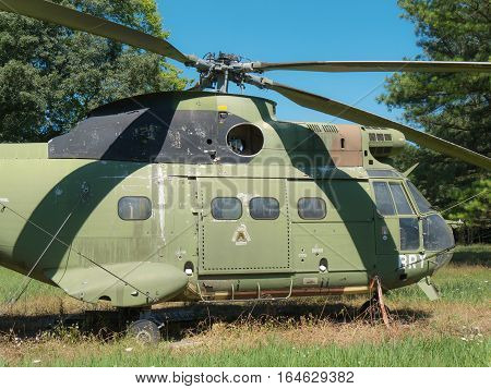 the wreck of a old military helicopter