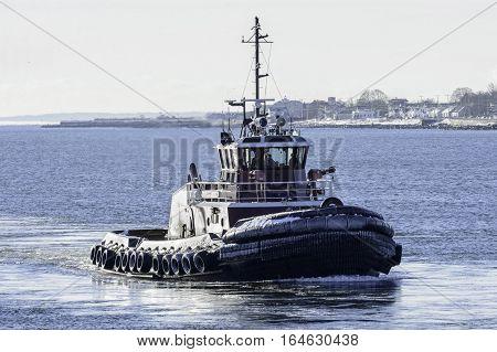 New Bedford Massachusetts USA - January 9 2017: Tug on Acushnet River in New Bedford Massachusetts on cold winter morning