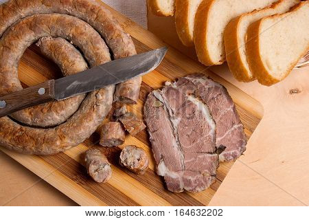 Sliced Roasted Traditional Homemade Sausage With Spices And Herbs. Baked Pork With Herbs And Spice O