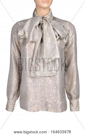elegant blouse from brocade fabric with large bow on a mannequin isolated on white