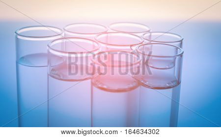 Pipette adding of several test tubes medical glassware.