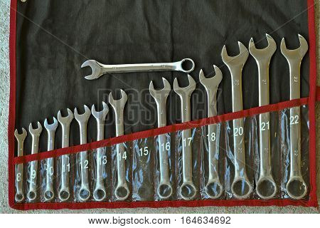 Old set of stainless steel wrenches, old combination spanners set. Top view