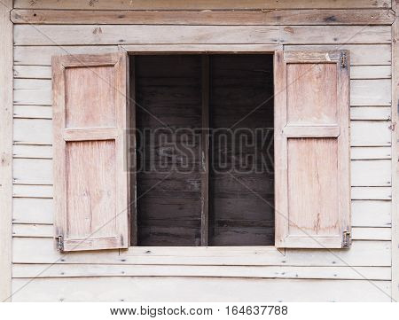 Old wooden wall in the room see through vintage window.
