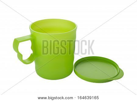 Plastic mug with lid on a white background