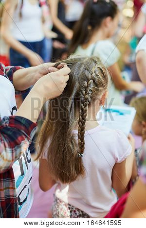 Young Girl And Her Pigtail Hair