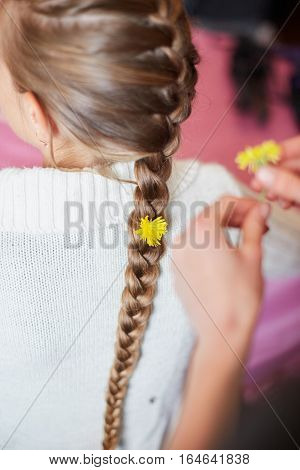 Young Girl With Flowers In Her Pigtail Hair.