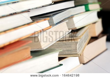 Messy pile of books. Selective focus low aperture shot