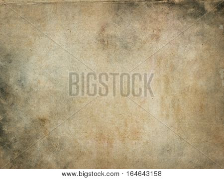 Aged yellowed paper background for the design. Grunge paper.