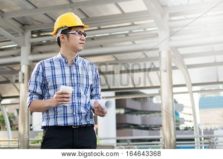 Foreman construction worker holding blueprint, architecture, safety