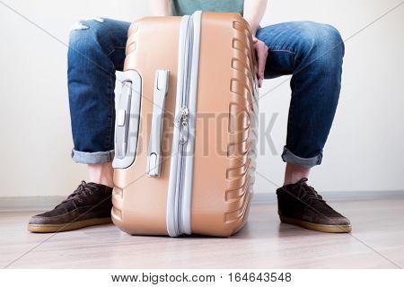 Sitting On Baggage
