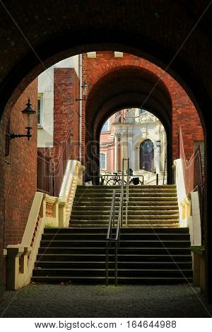 Intimate view of an Hamburg spot. The stairs leads to a passage which ends in a square. A bike is visible on the side