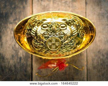 Chinese Gold Ingot, Chinese Gold Nugget And Red Bag On Wooden Background