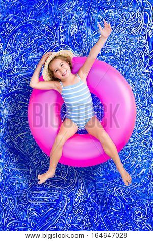 Confident Happy Little Girl In A Swimming Pool