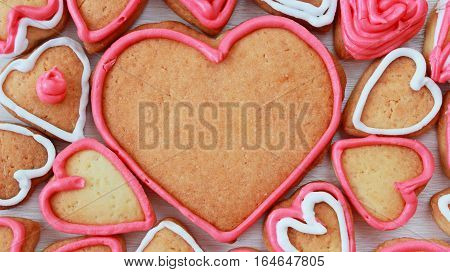 background with heart shape valentine homemade cookies on light wooden background