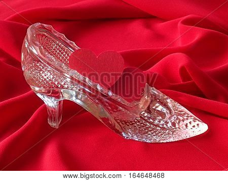 Two red hearts in the glass slipper