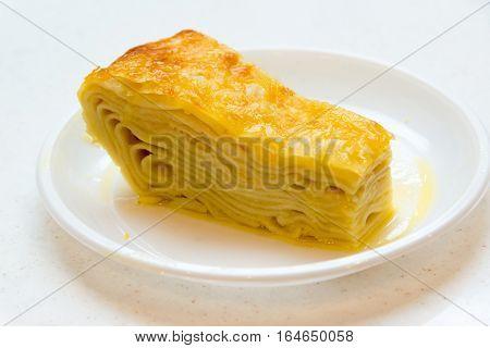 A piece of khachapuri a puff on a plate