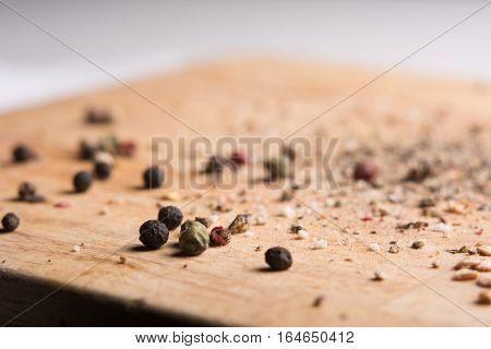 On A Wooden Board, Ground Pepper And Peas