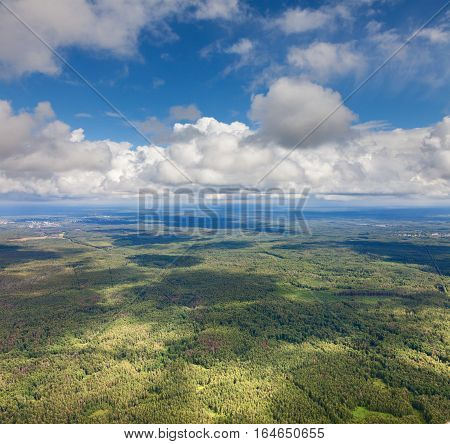 Aerial view of the forest in cloud summer day.