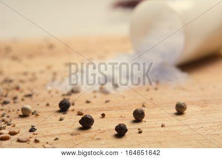 Pepper And Salt On A Kitchen Wooden Board