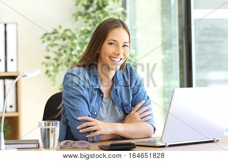 Proud freelance woman posing at office and looking at you