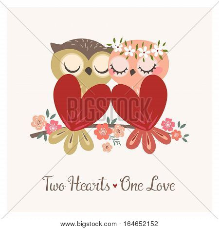 Greeting card with two cute owls in love sitting on flower branch for Valentine's day or wedding congratulations.