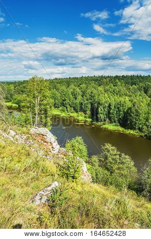 Beautiful landscape. The endless forest and the rocks along the river Chusovaya. Russia. Ural
