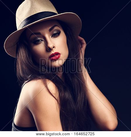 Beautiful Sexy Female Model Holding The Hand Cowboy Summer Hat And Posing On Dark Background. Fashio