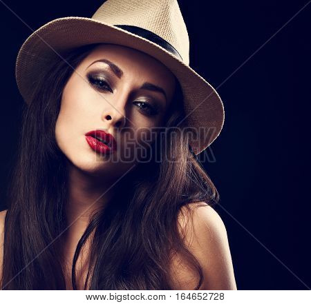 Beautiful Sexy Woman Posing In Cowboy Summer Hat With Bright Red Lips On Dark Black Background. Clos