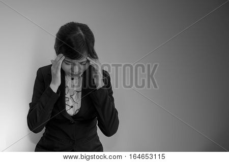 Business woman headache in black suit on black and white concept