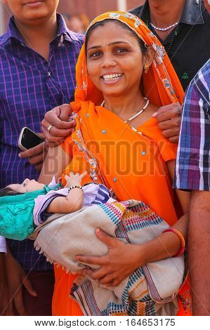 Agra, India - November 7: Unidentified Woman With A Baby Stands In Agra Fort On November 7, 2014 In