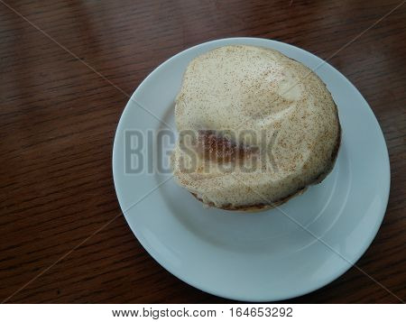A Delectable and Sweet Cinnamon Bun on a Table