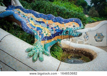Barcelona Spain - October 27 2015: The salamander statue in Park Guell has become a symbol of Gaudí's work in Barcelona Spain on 27 October 2015.