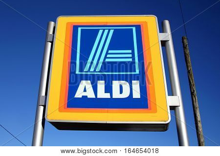 Carmarthen, Wales, UK - January 2, 2017:  Aldi logo advertising sign outside its retail supermarket stores in the city centre