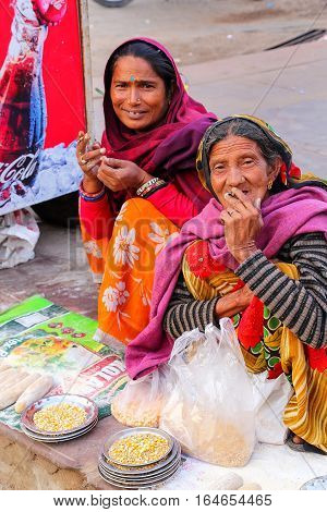Amber, India - November 13: Unidentified Women Sell Fish Food Near Maota Lake In Amber On November 1