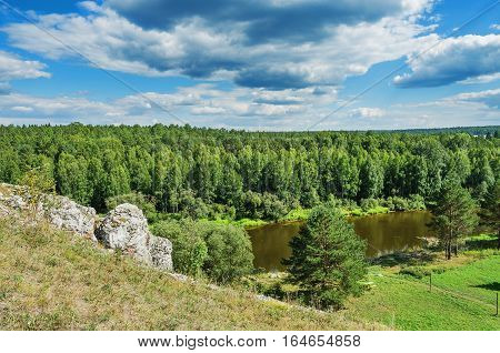 Beautiful summer landscape with a river cliffs and clouds. The Chusovaya river. Russia. Ural