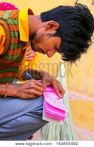 Amber, India - November 13: Unidentified Man Writes Receipt In Amber Fort On November 13, 2014 In Am