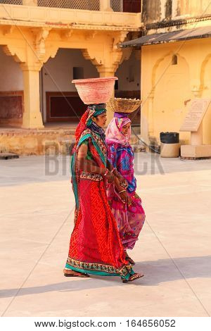 Amber, India - November 13: Unidentified Women Walk With Pots On Their Heads In Amber Fort On Novemb