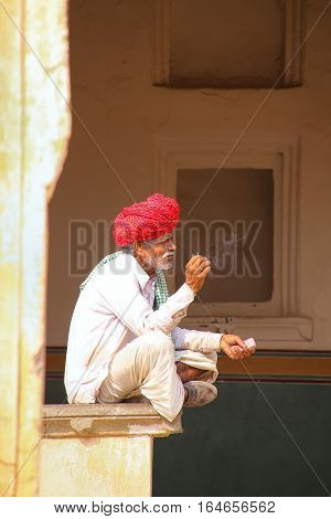 Amber, India - November 13: Unidentified Man Sits In The Fourth Courtyard Of Amber Fort On November