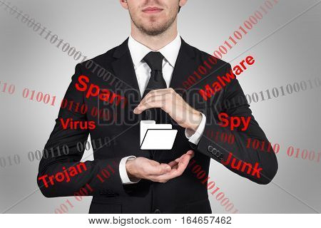 businessman in suit protecting file folder symbol spam malware