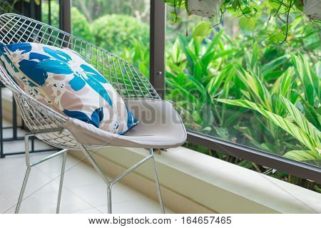 resting seat with pillow near in a cozy balcony in the morning