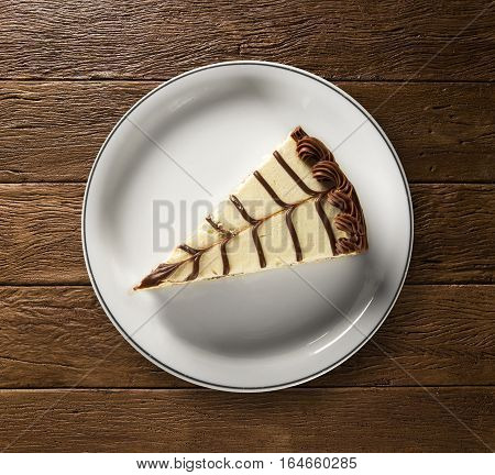 Souffle with chocolate on wooden background. Dutch pie.