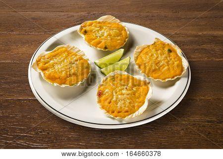 Siri food portion with lime. Snack seafood