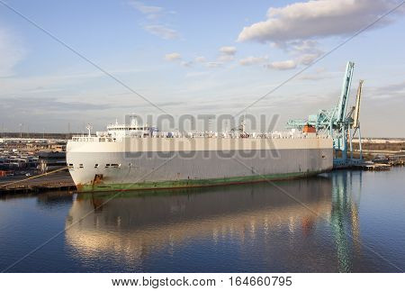 The view of a cargo ship and calm evening reflections in Jacksonville (Florida).