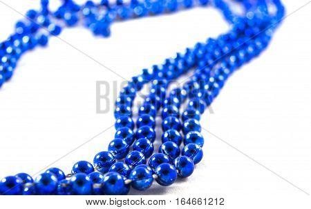 blue beads onblue beads on white background white background