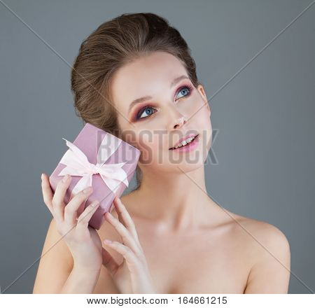 Young Woman Model with Pink Gift Box